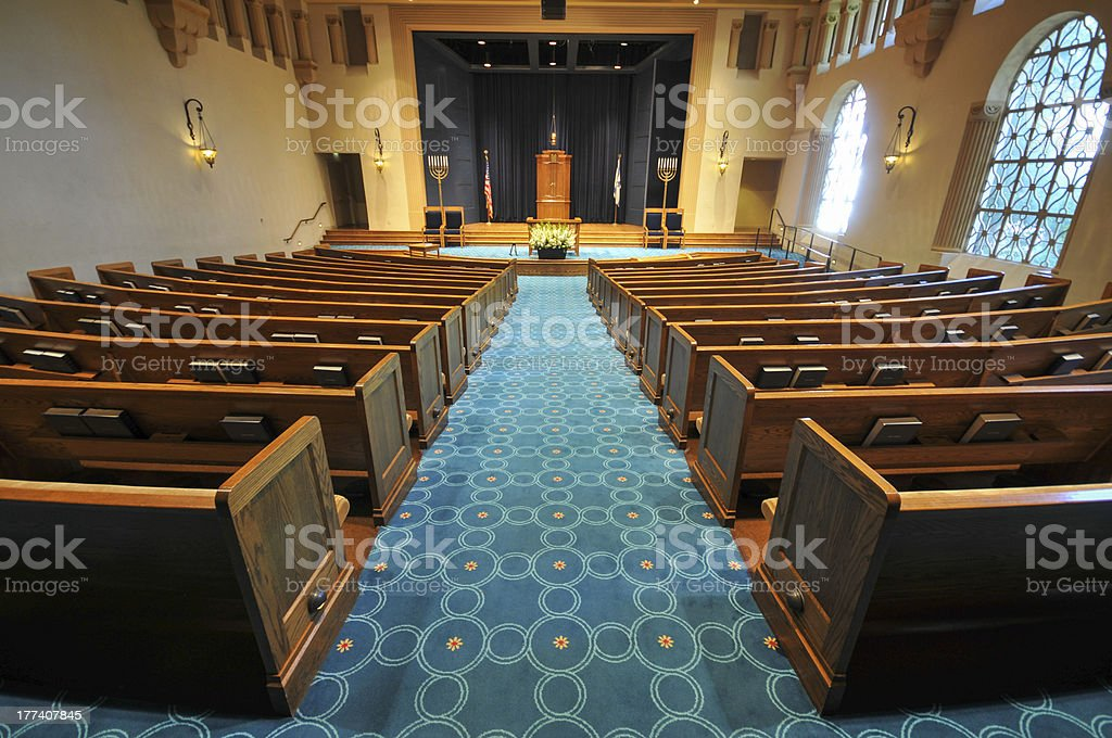 Rows of pews in a synagogue stock photo