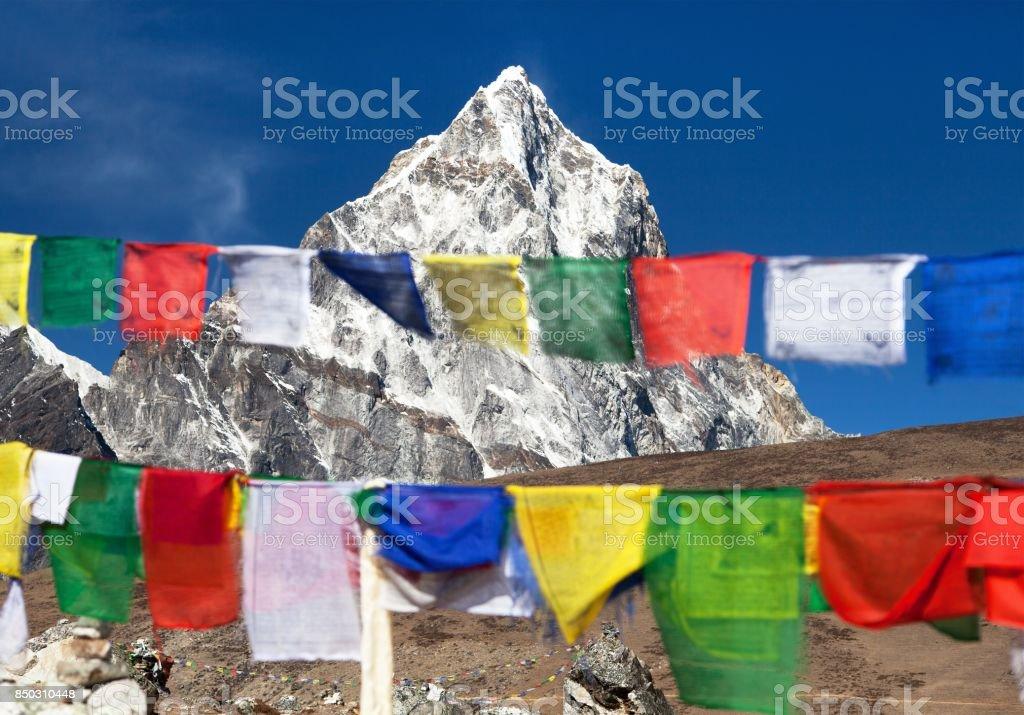 Rows of prayer flags and mount Arakam Tse stock photo