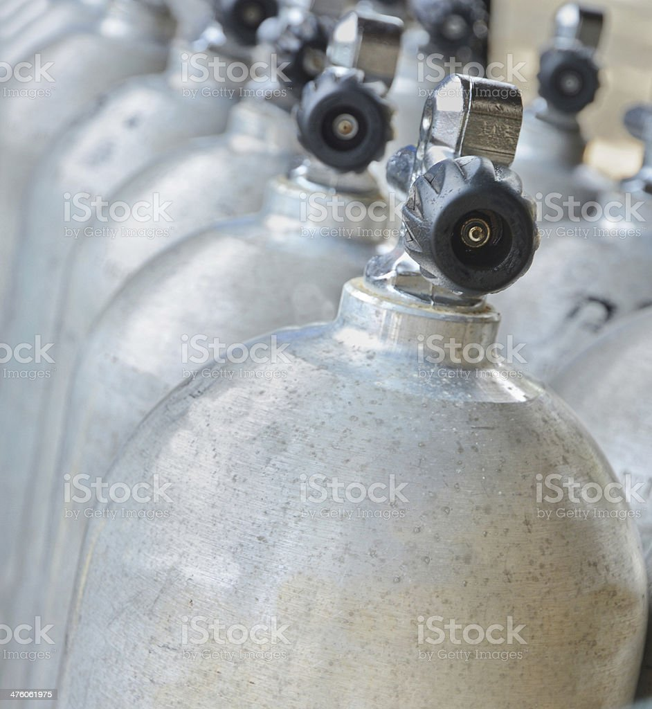 rows of scuba cylinders stock photo