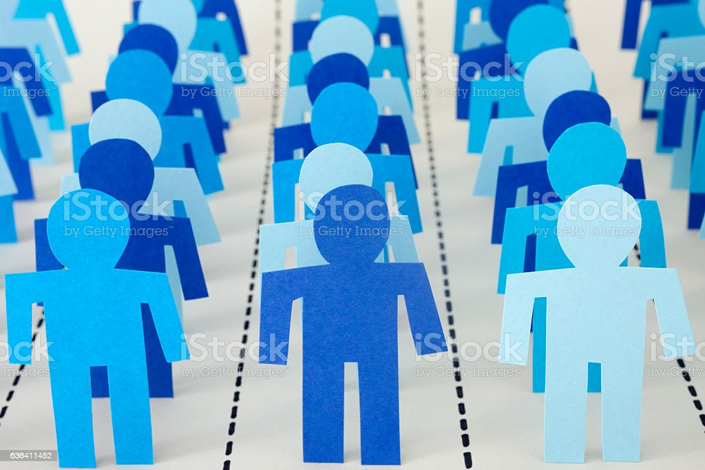 Rows of separated blue men stock photo
