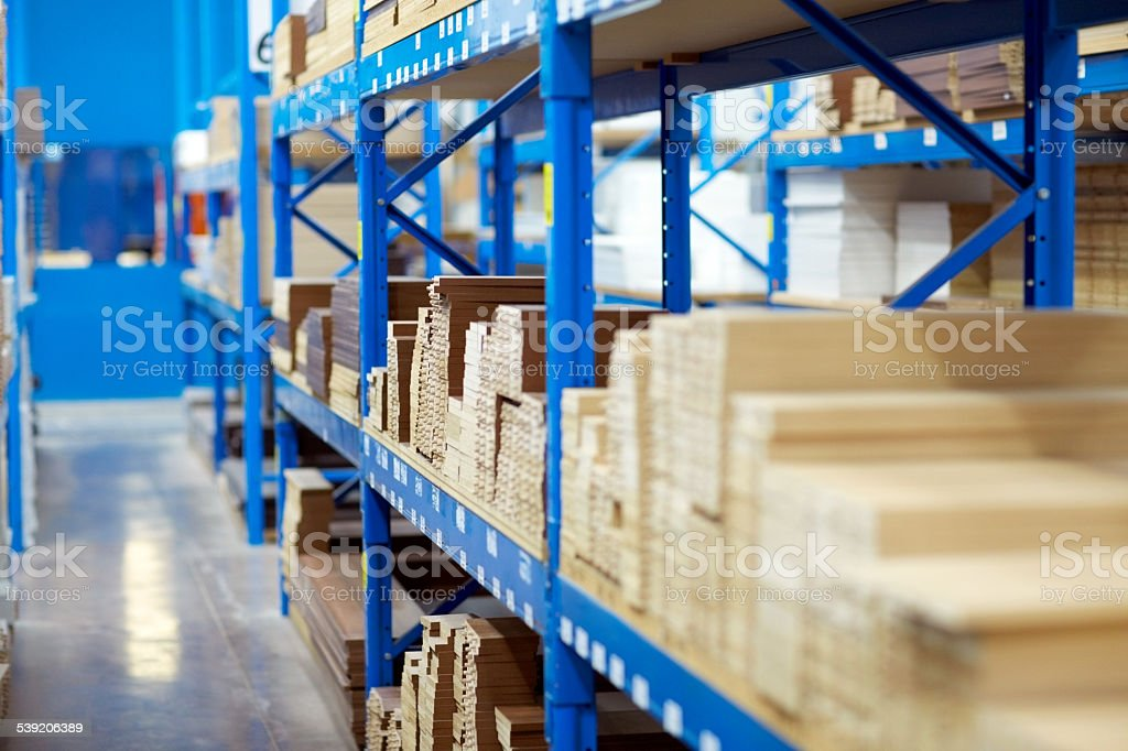 Rows of shelves with wooden planks stock photo