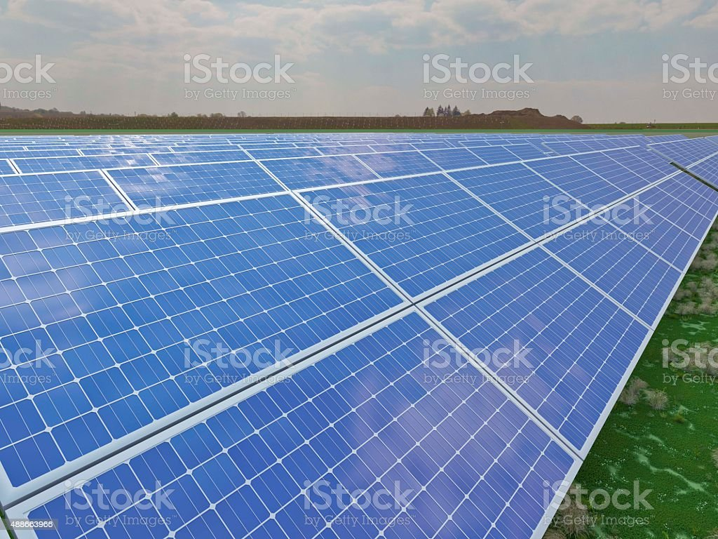rows of solar panels in the sun stock photo