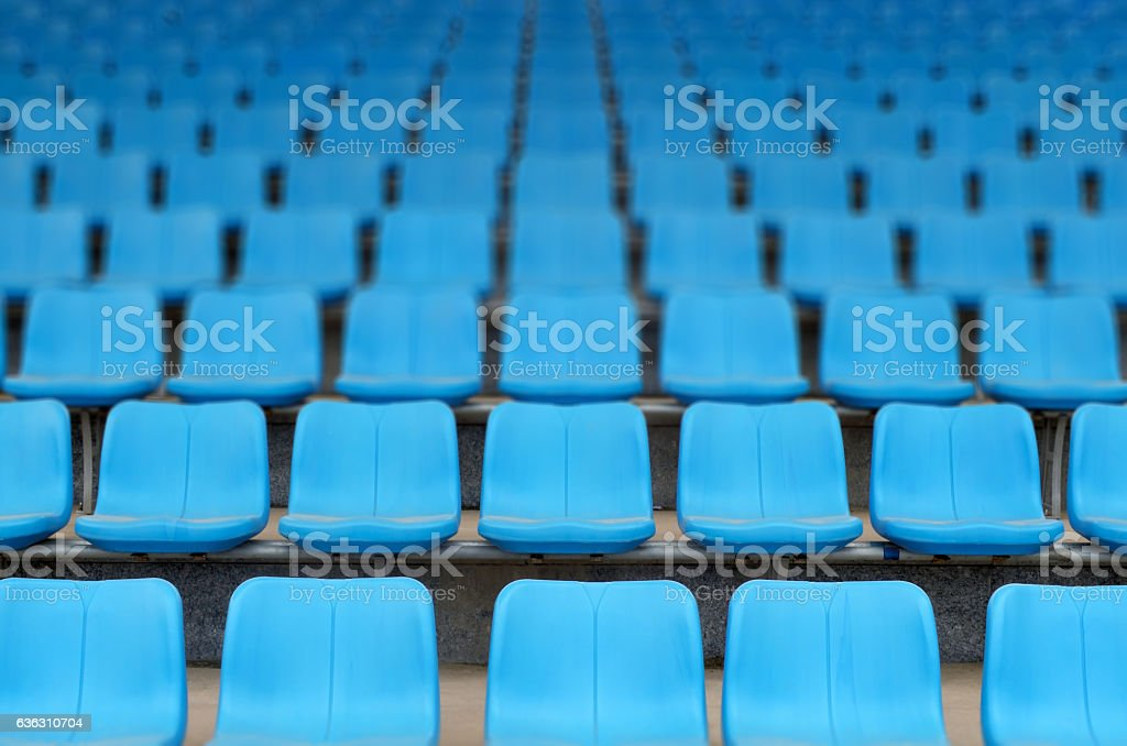 Rows of stadium grandstand seats stock photo