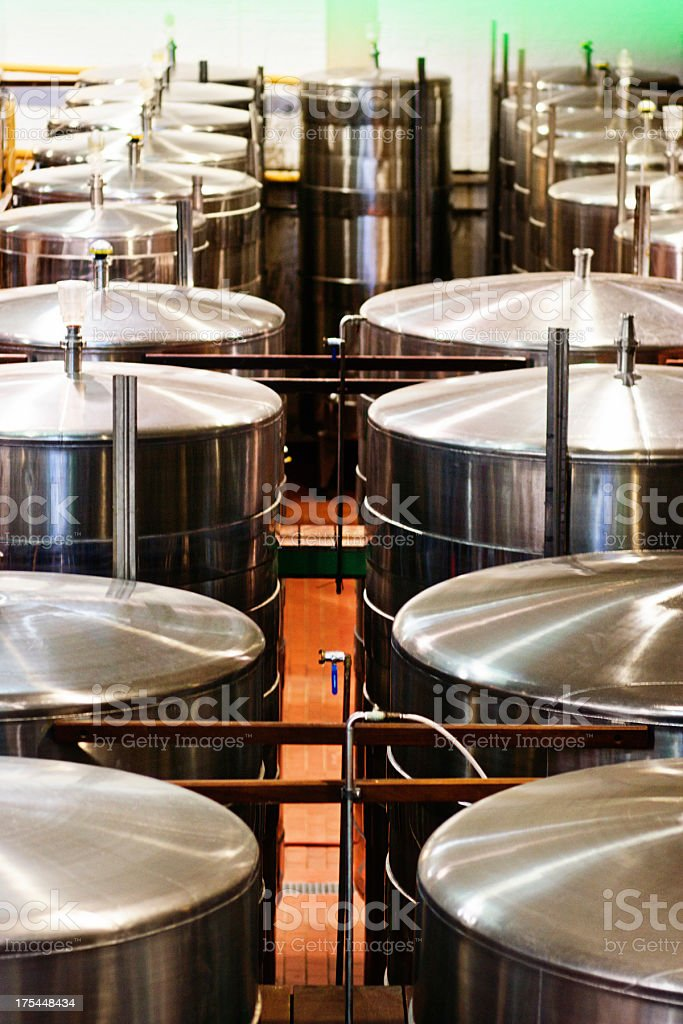 Rows of stainless steel fermentation vats at modern winery royalty-free stock photo