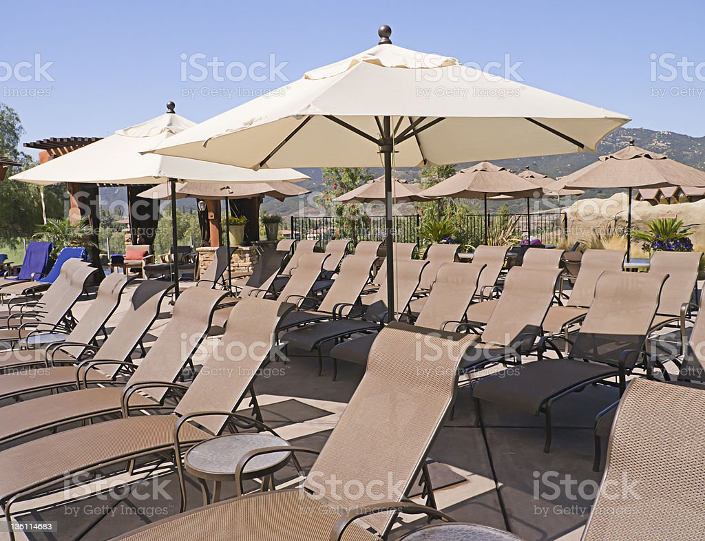 Rows of sunloungers with parasols stock photo