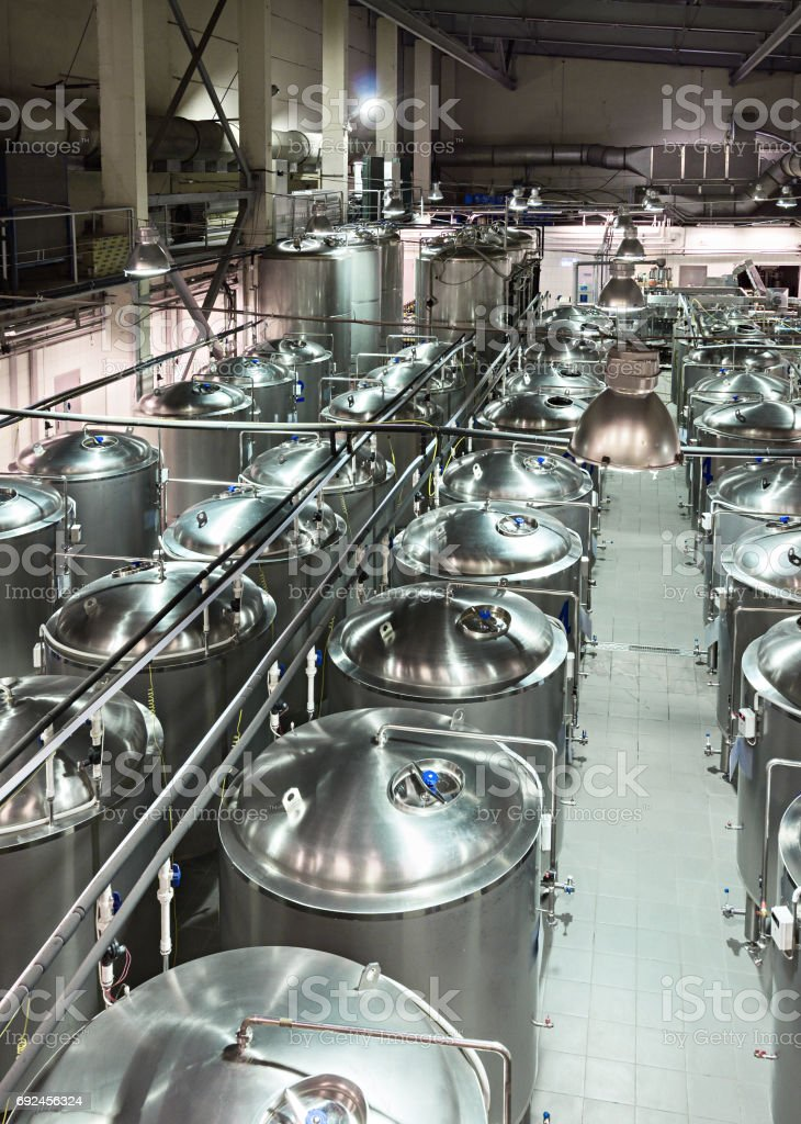 Rows of tanks made of food grade stainless steel stock photo