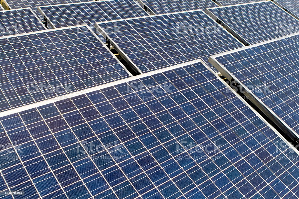Rows of Tilted Photovoltaic Solar Panels royalty-free stock photo