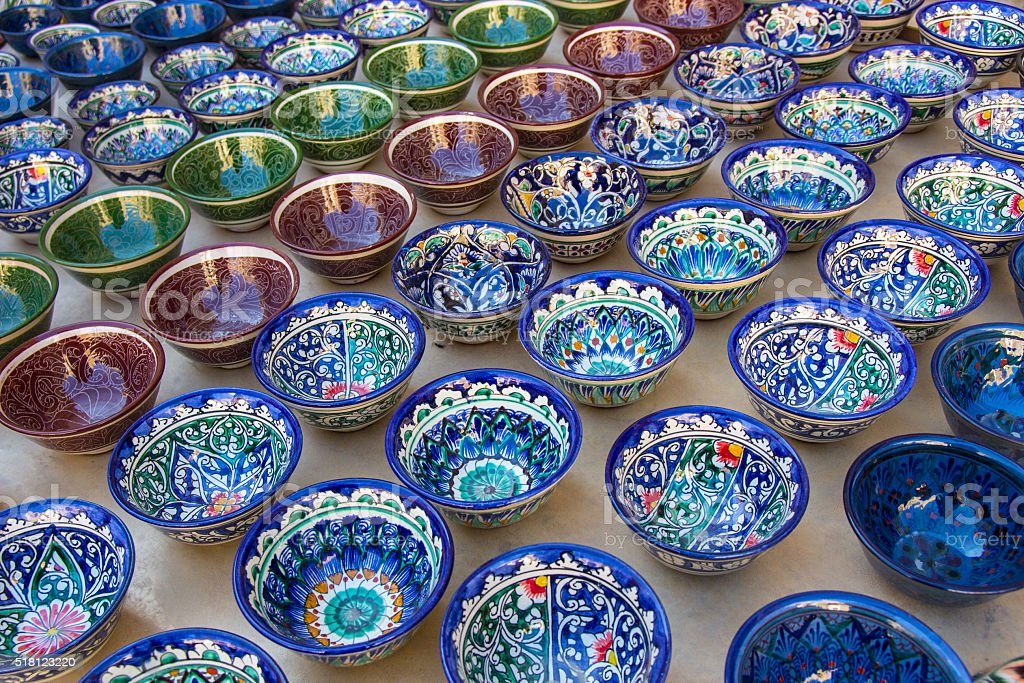 Rows of uzbek cups with traditional uzbekistan ornament stock photo