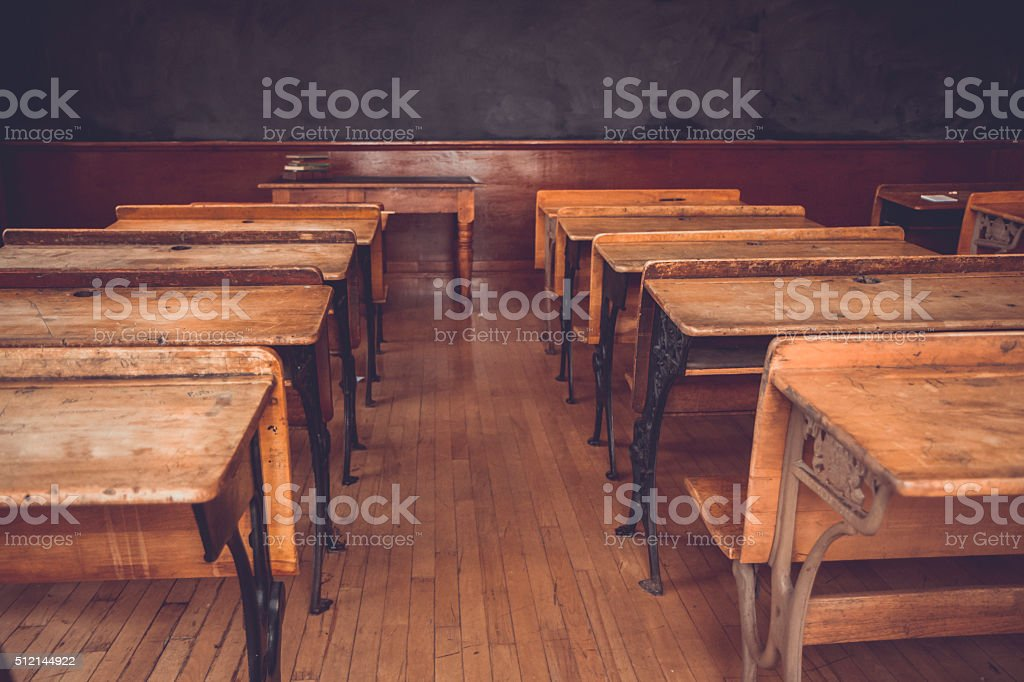 Rows of Vintage Student Desks in An Old Schoolhouse stock photo