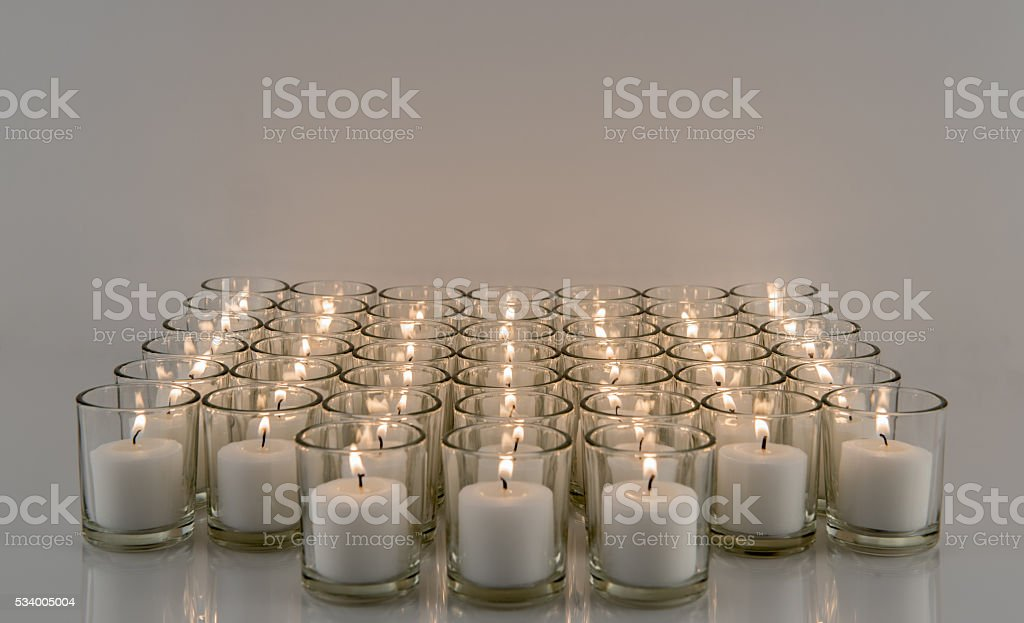 Rows of Votive Candles stock photo