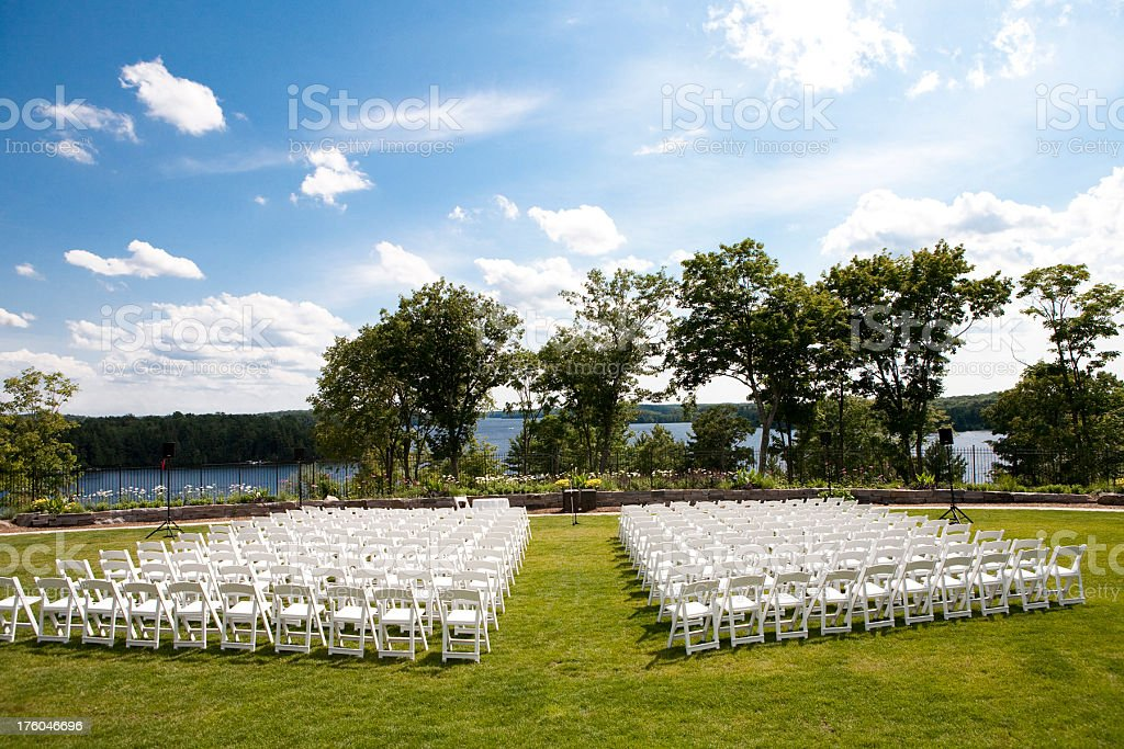 Rows of white chairs on a resort royalty-free stock photo