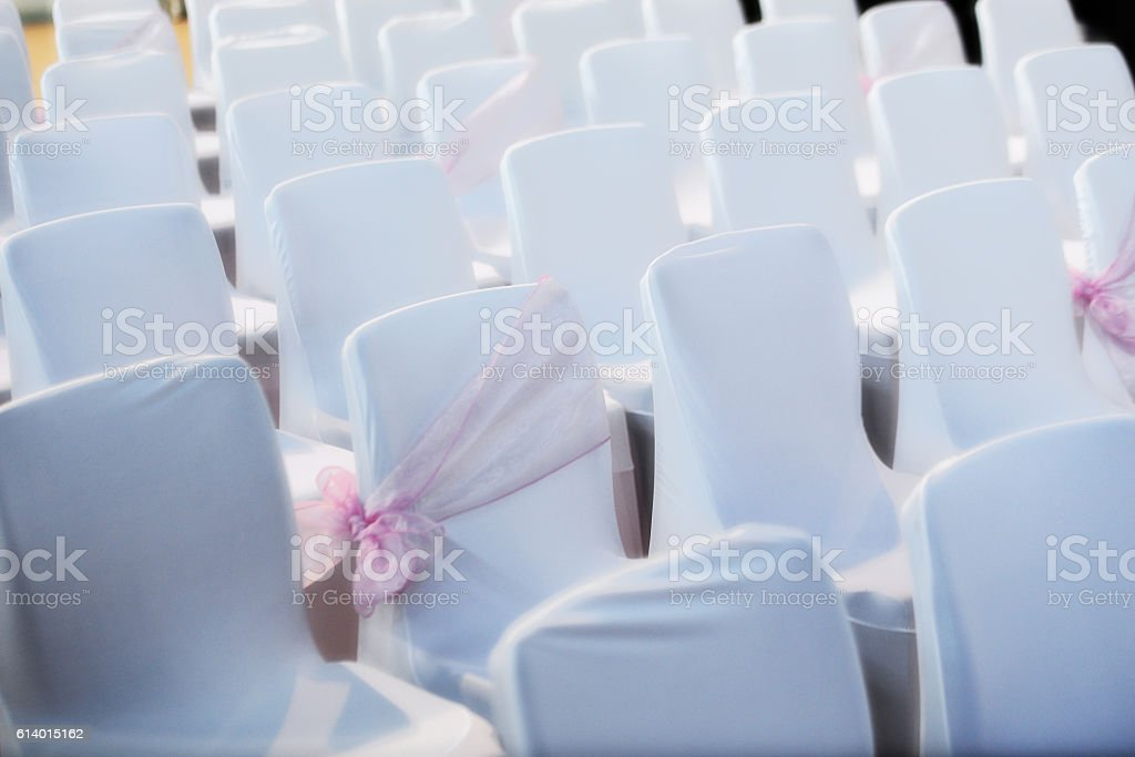 Rows of white chairs stock photo