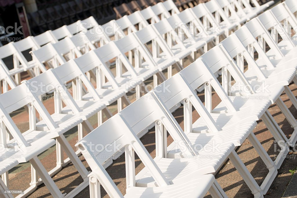 Rows Of White Plastic Chairs stock photo