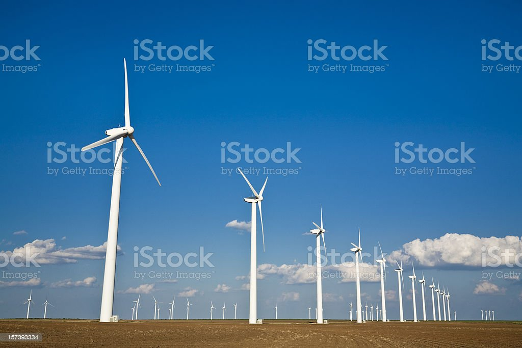 rows of wind turbines on the West Texas plains royalty-free stock photo