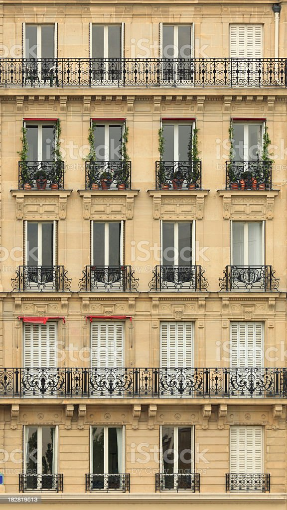 Rows of windows with wrought iron railing royalty-free stock photo