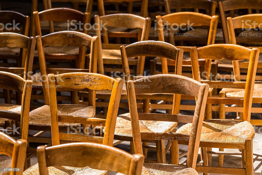 Rows of wooden chairs royalty-free stock photo