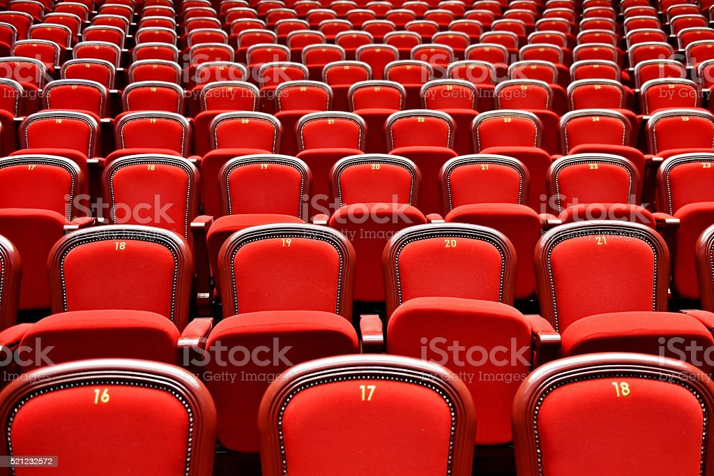Rows with empty seats in a theater stock photo