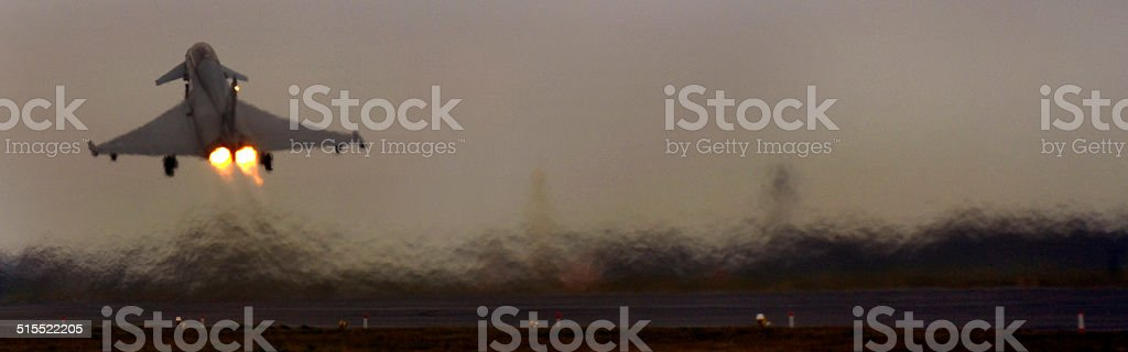 Royal Air Force RAF Typhoon Eurofighter, takes off, haze, runway. stock photo