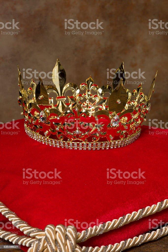 Royal crown on pillow stock photo