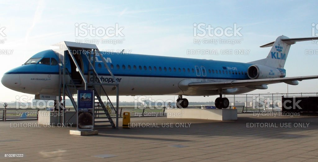 KLM Royal Dutch Airlines Fokker 100 Parked At Amsterdam Schiphol Airport In The Netherlands Western.Europe stock photo