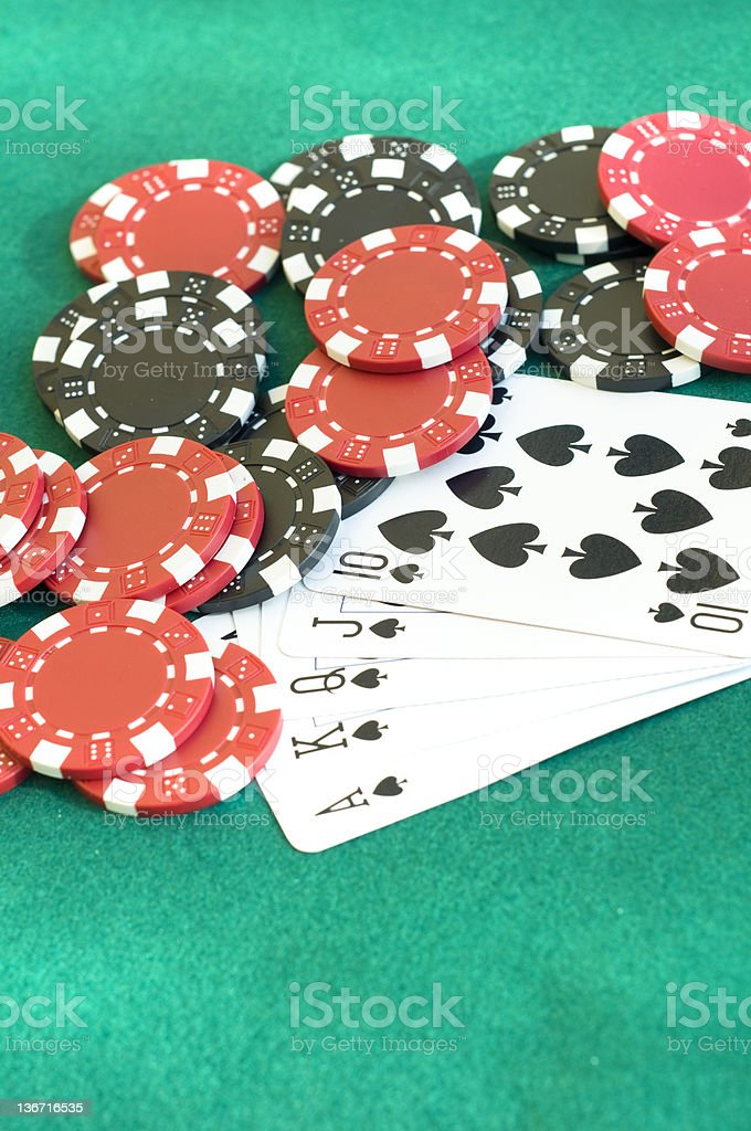 Royal flush on the green table stock photo