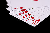Royal flush. Playing cards isolated on black  background