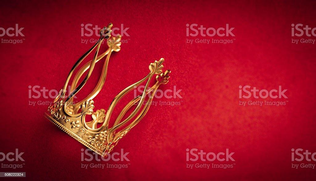Royal golden crown on red velvet stock photo
