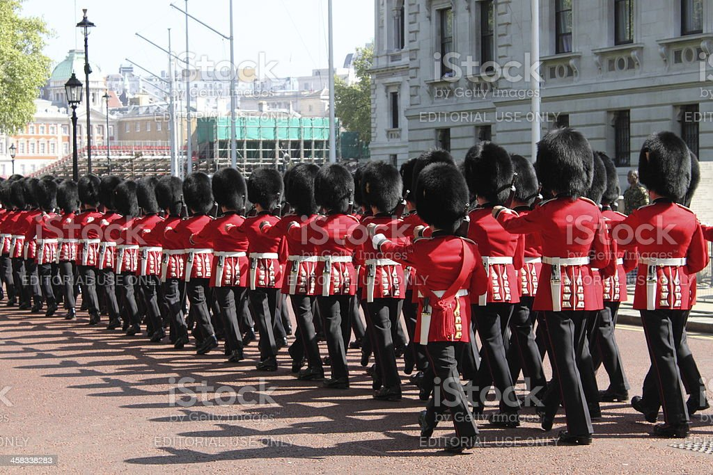 Royal Guards march toward Buckingham Palace royalty-free stock photo