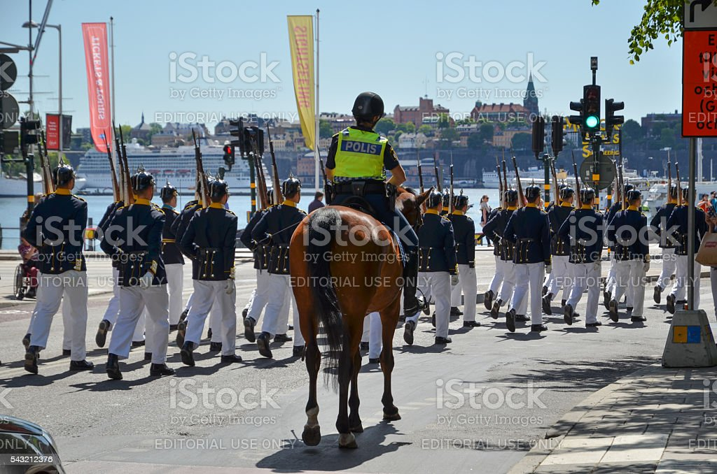 Royal Guards with police escort in Stockholm, Sweden stock photo