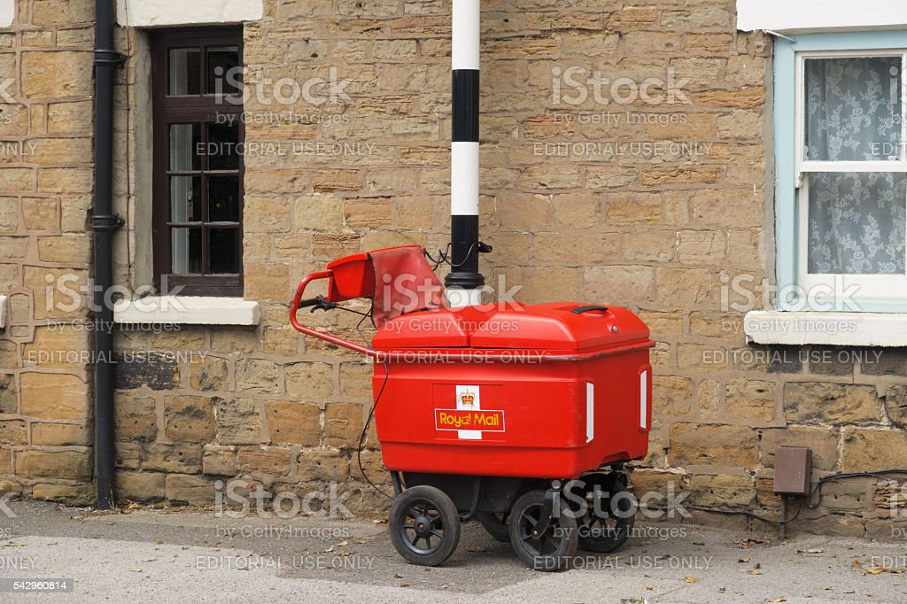 Royal Mail high capacity trolley chained to a post. stock photo