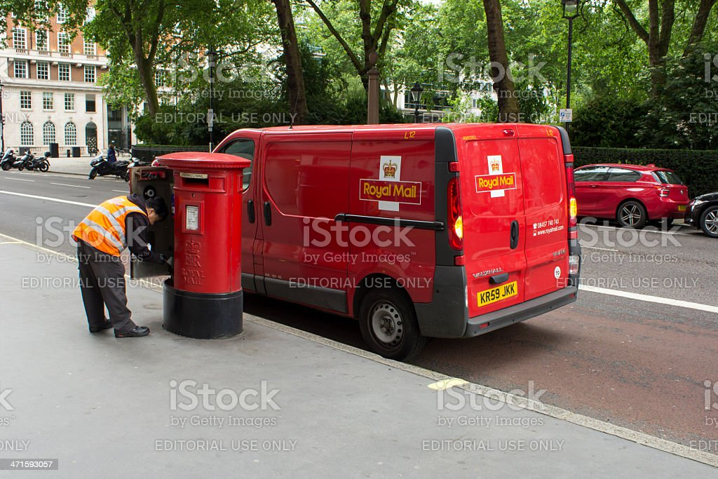 Royal Mail man collecting the post stock photo