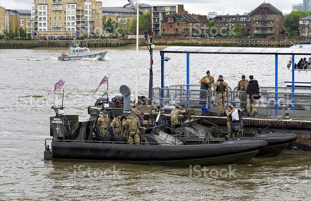 Royal Marines disembarking at Greenwich on Jubilee weekend royalty-free stock photo