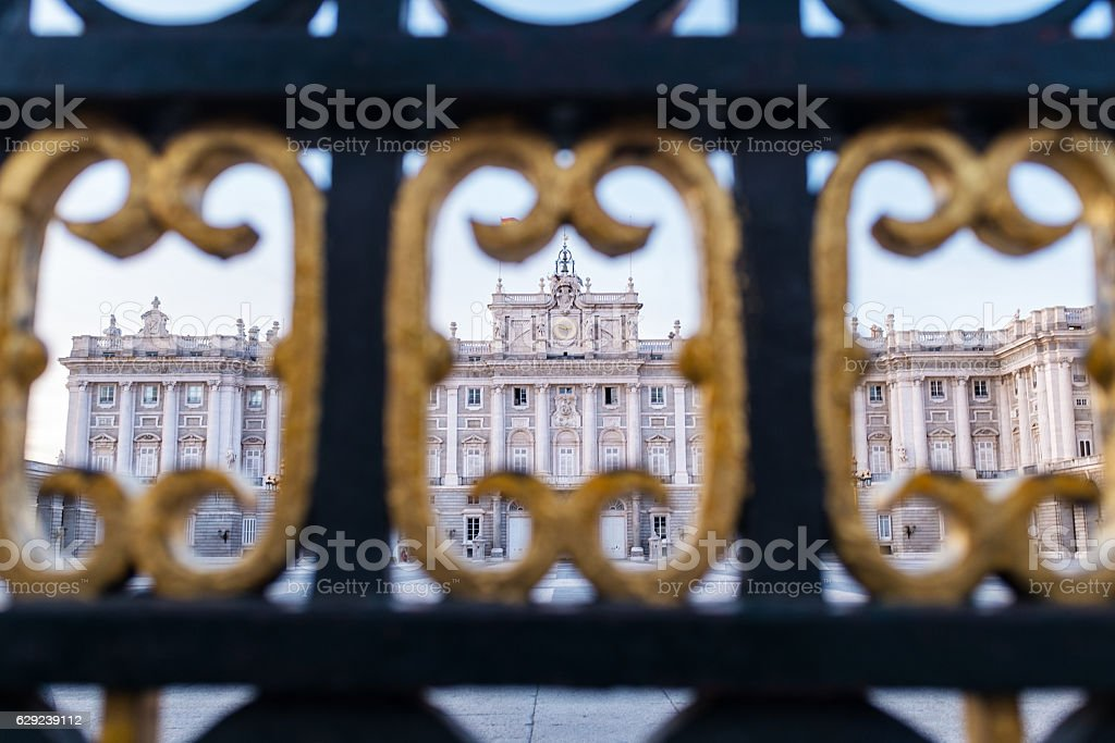 Royal Palace seen through the gates in Madrid stock photo