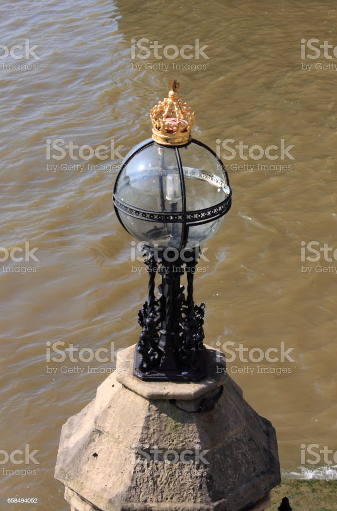 Royal street lamp on the river Thames stock photo
