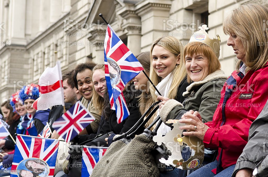 Royal Wedding crowd waving flags, morning, central London stock photo