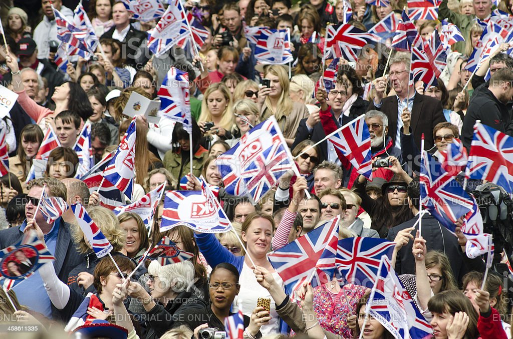 Royal Wedding crowd waving flags stock photo