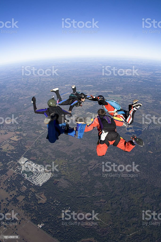Royalty Free Stock Photo: Four Skydivers in Freefall Formation stock photo