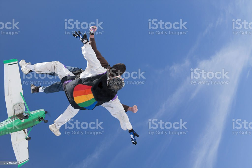 Royalty Free Stock Photo: Tandem Skydivers and the Airplane stock photo