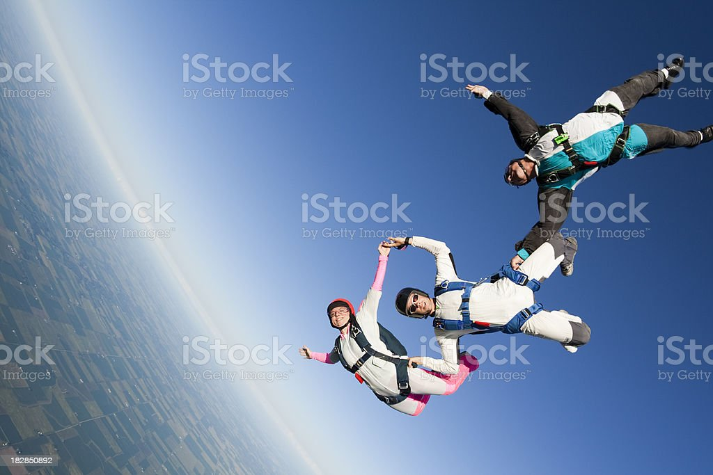 Royalty Free Stock Photo: Three Skydivers in Freefall stock photo