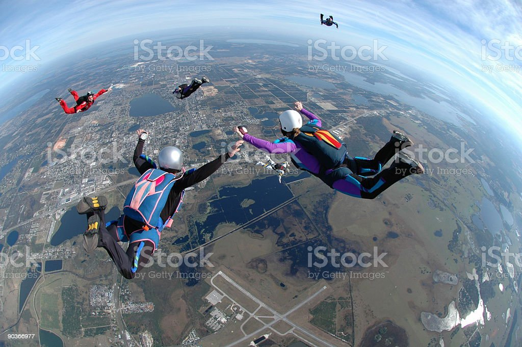 Royalty Free Stock Photo:  Women Skydiving - Flying High royalty-free stock photo