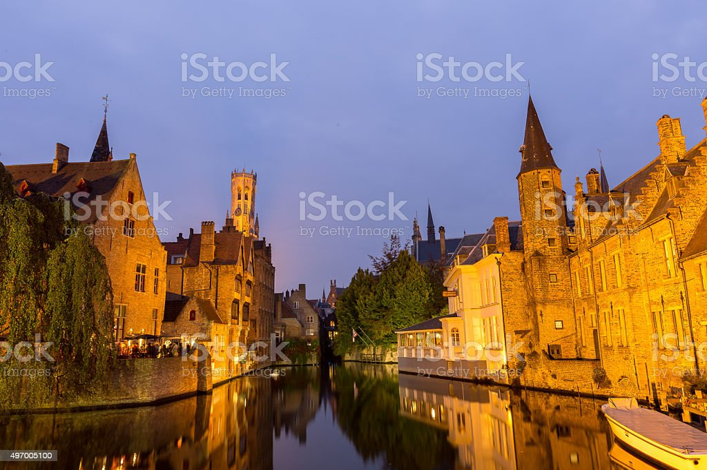 Rozenhoedkaai at dusk in Bruges,Belgium with belfry tower. stock photo