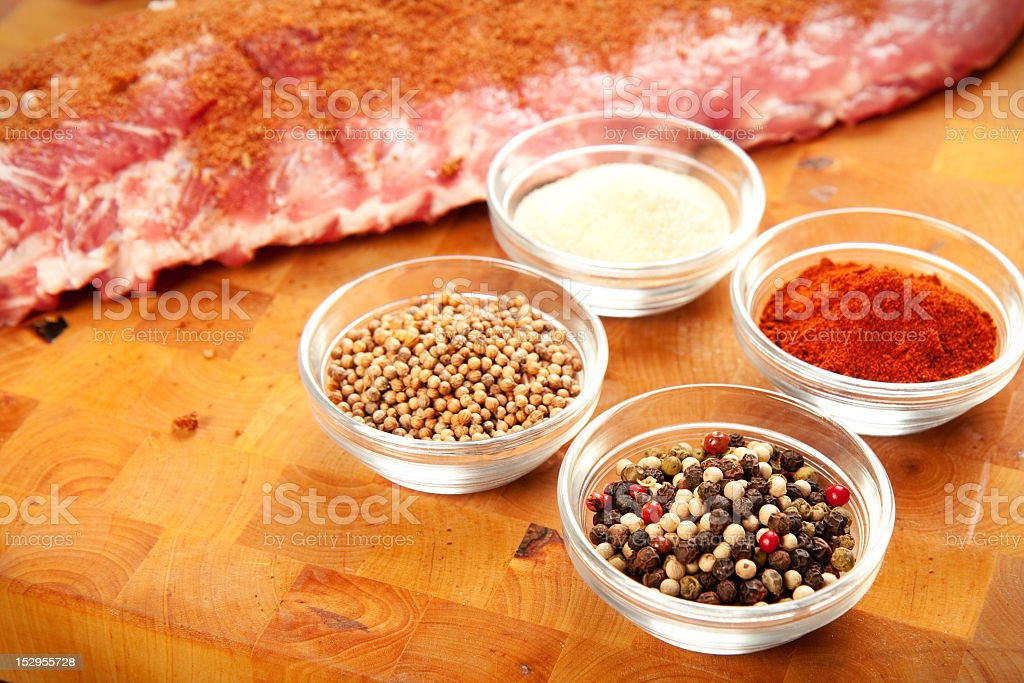 A rub of various spices being prepared for barbecuing meat stock photo