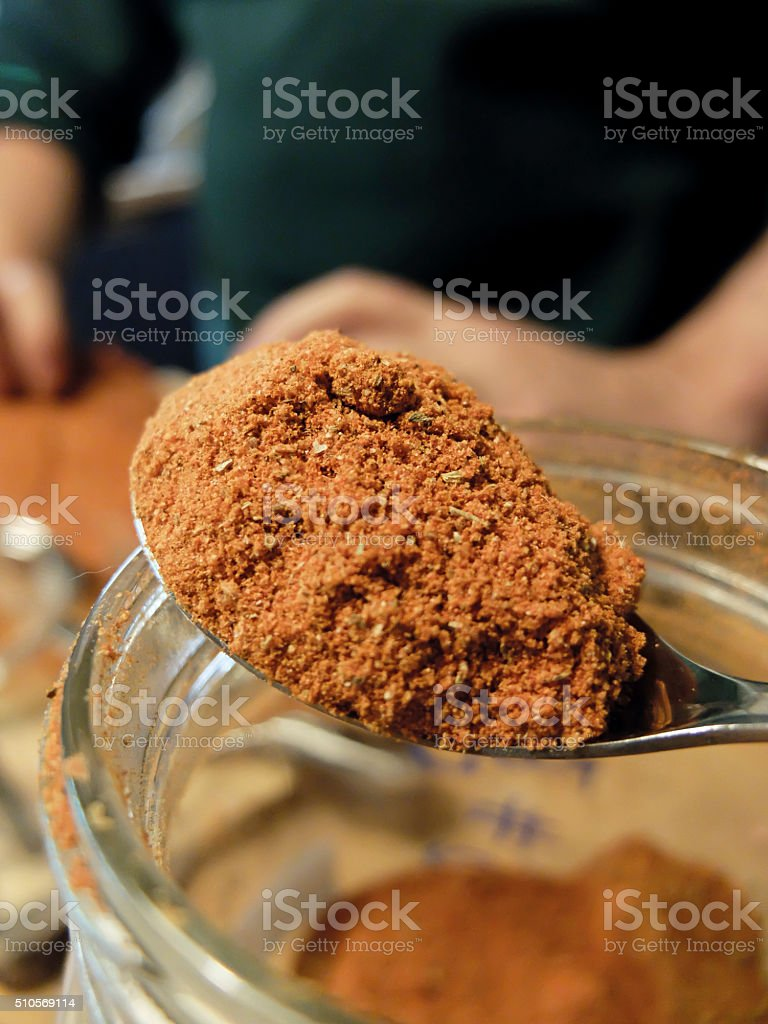Rub spice mixture on a spoon stock photo