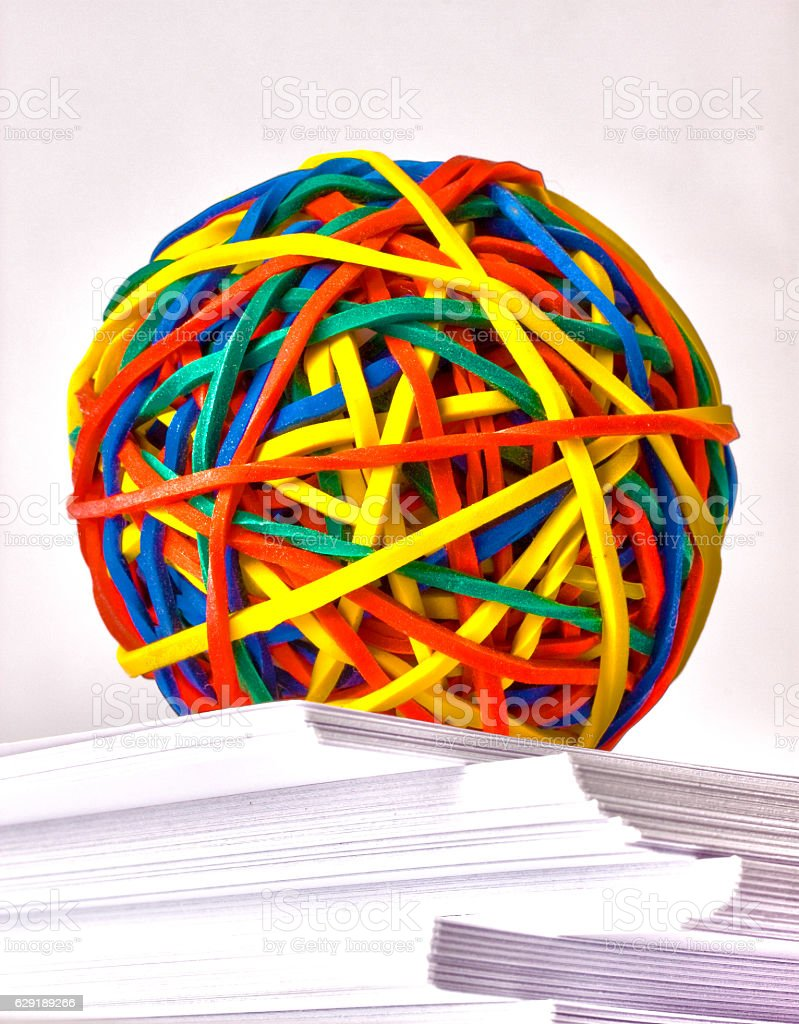 Rubber Band Ball in a Paper Ream stock photo