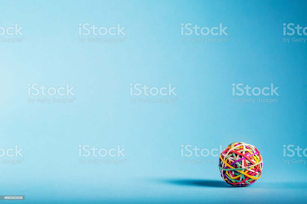 Rubber band ball on blue background stock photo