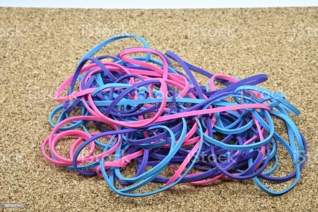 Rubber Bands On Cork Board stock photo