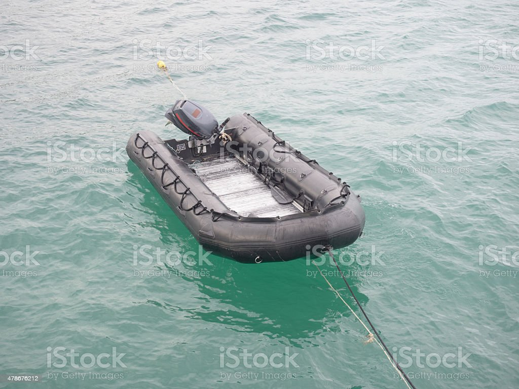 rubber boat  at the waterside stock photo
