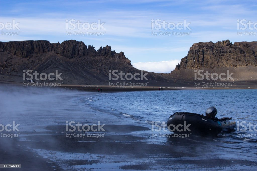 Rubber boat in the fog of Deception Island stock photo