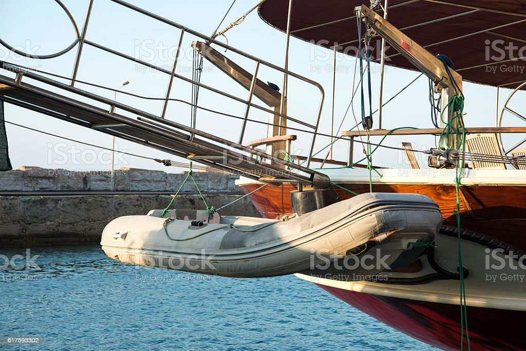 Rubber Boat On The Back Of The Yatch stock photo