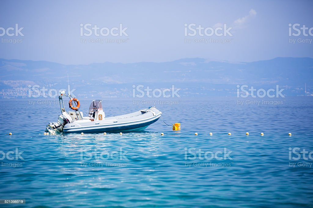 rubber boat on the sea stock photo